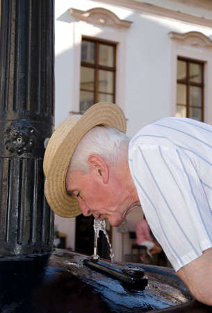 Senior drinking from the fountain
