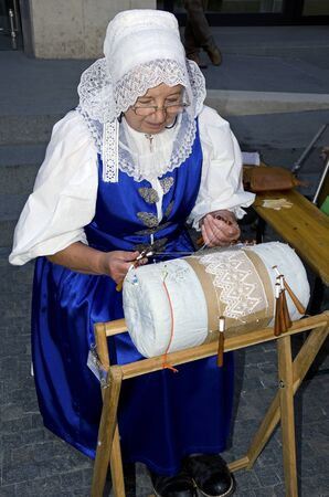 bobbin: The demonstrating of the bobbin lace Editorial
