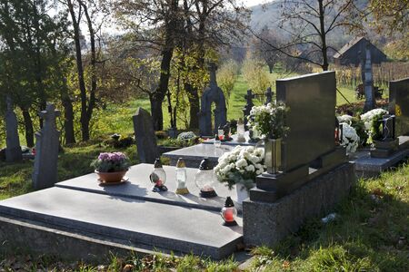 all saints day: The grave on rustic slovak cemetery on All Saints Day.