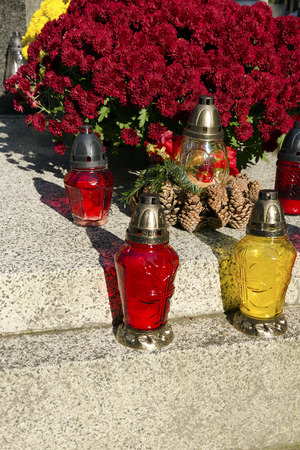 all saints day: The burners and chrysanthemums on the grave on All Saints Day.