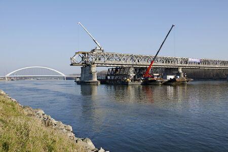 stary: The Bratislava Stary most bridge demounting with Apollo bridge Stock Photo