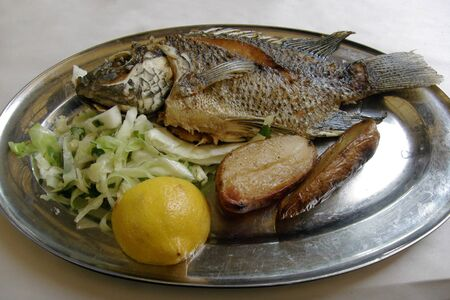 St. Peters fish, a typical meal for christian pilgrims by sea of Galilee. Stock Photo