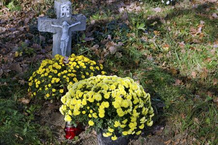 all saints  day: The old rustic grave on cemetery on All Saints Day. Editorial