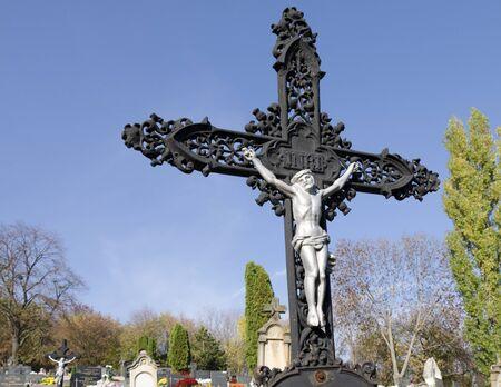 slovak: The old iron gravestone cross on rustic slovak cemetery.