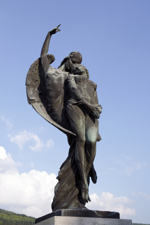 lux: SPISSKE PODHRADIE, SLOVAKIA - AUGUST 10, 2014: The angel takes the soul to heaven. The bronze sculpture by Alexej (Elek) Lux (1883-1941) on the grave monument of Jan Harmatta and his wife.
