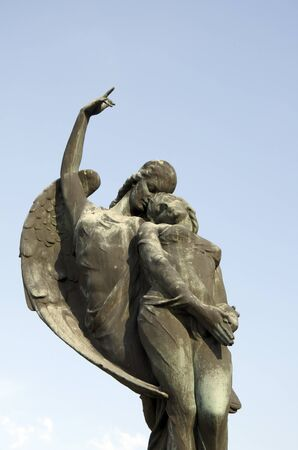 angel headstone: SPISSKE PODHRADIE, SLOVAKIA - AUGUST 10, 2014: The angel takes the soul to heaven. The bronze sculpture by Alexej (Elek) Lux (1883-1941) on the grave monument of Jan Harmatta and his wife.
