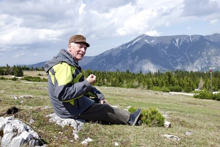 Senior in the mountains Austria Stock Photo