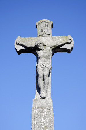 stone tombstone: The Christ on the cross: the old stone tombstone