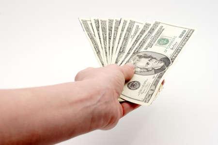 handing: Arm holding money on white background