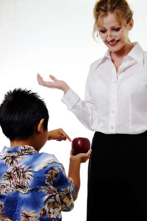 touched: Boy showing teacher apple