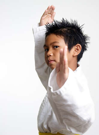 asian art: Kid in fighting stance Stock Photo