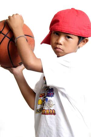 Pensive boy holding a basketball Stock Photo - 221860