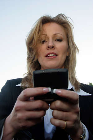 pager: Business woman checking message