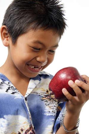 Boy admiring a red apple Stock Photo - 221840