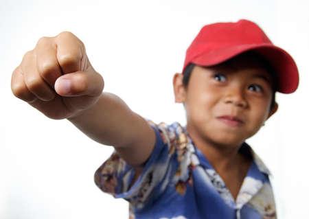 accomplishes: Child Accomplishes and raises fist Stock Photo