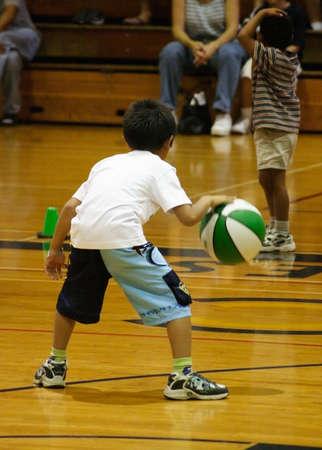 Boy dribbling basketbal