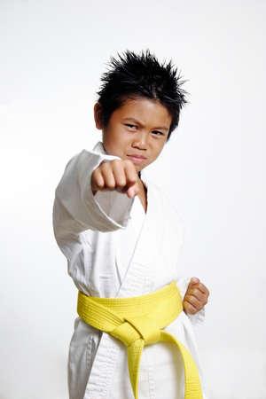 karate: Boy with yellow belt Practicing Karate Stock Photo