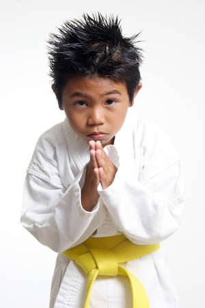 asian art: Cute Karate kid bowing Stock Photo