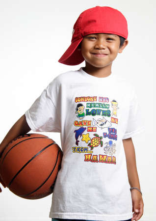 lad: Smiling young lad holding his basketball
