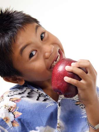 Child biting on apple Stock Photo - 222441