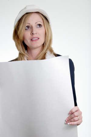 oversee: Lady architect holding blueprints Stock Photo