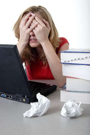 essay: Frustrated woman working on computer Stock Photo