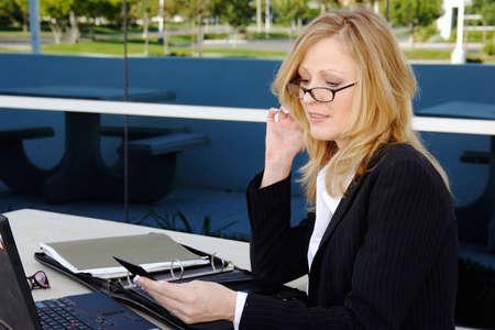 Business woman working outside on lunch break photo