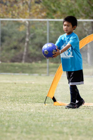 sportsmanship: Young boy playing goalie in soccer