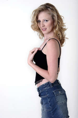 Blonde wearing blank tank and jean mini skirt photo