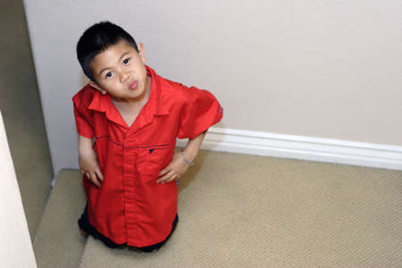 pucker: Cute kid in red Stock Photo