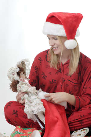 morning glory family: Lady with doll at Christmas Stock Photo