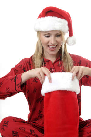 morning glory family: Woman looking into her stocking on Christmas morning