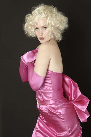 pink satin: Woman posing in pink satin formal gown