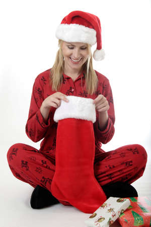 Woman looking in her Christmas stocking photo