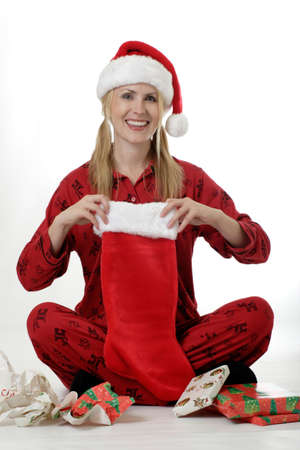 morning glory family: Woman unwrapping gifts on Christmas Stock Photo