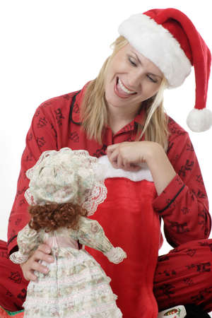 morning glory family: Woman playing with a doll on Christmas Stock Photo