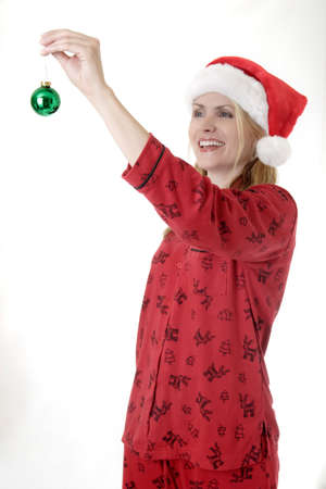 morning glory family: Woman about to hang a Christmas ornament Stock Photo