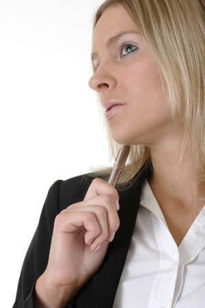Attractive Business woman holding pen thinking