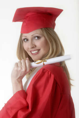 achievment: Woman in cap and gown holding diploma Stock Photo
