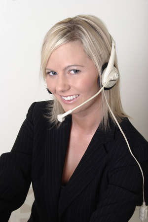 Pretty lady switchboard operator wearing headset photo