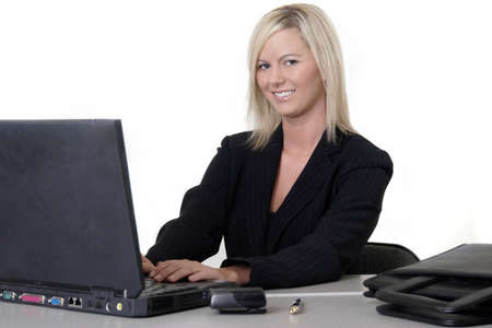 Attractive woman typing on laptop