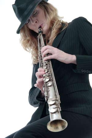 soprano saxophone: Se�ora que juega un saxophone del soprano Foto de archivo