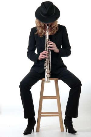soprano saxophone: Dama tocando el saxof�n  Foto de archivo