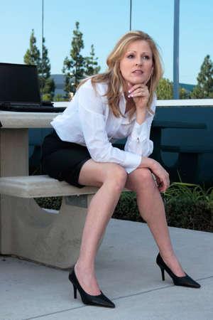 Business woman sitting outside photo