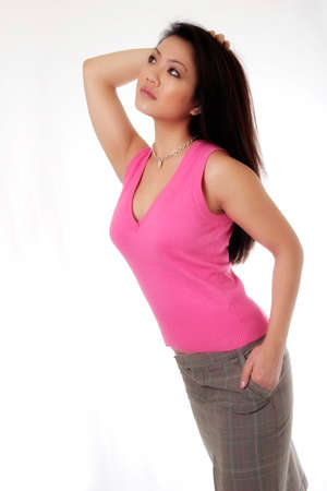 Attractive Asian woman posing in pink on white background Stock Photo - 292425