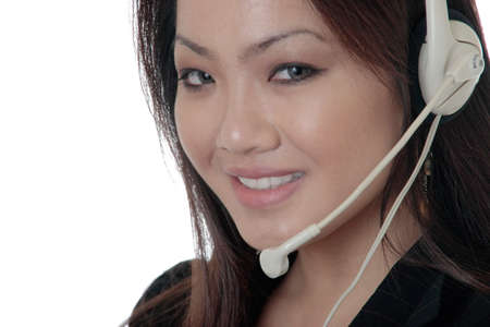 Attractive receptionist wearing headset up close on white background
