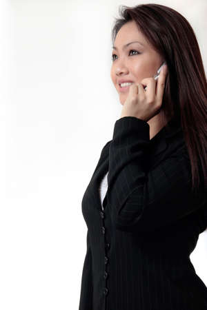 Attractive business woman talking on cell phone on white background Stock Photo
