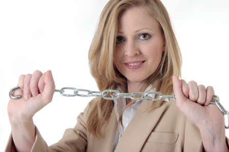 constraint: Woman holding both ends of a chain symbolizing constraint