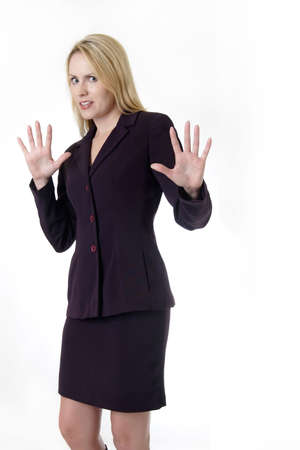 intimidated: Business woman with hands up saying back off Stock Photo
