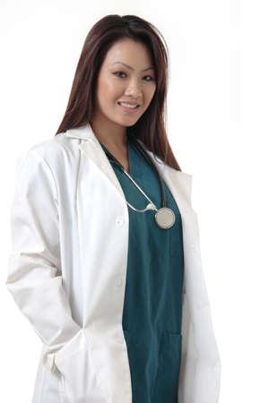 compassionate: Pretty Asian Doctor on white Stock Photo